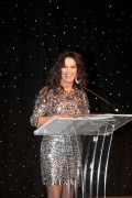 Marie Osmond in a short dress giving a speech - 2010